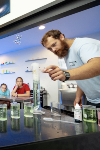 Astro Camp instructor conducting science experiment